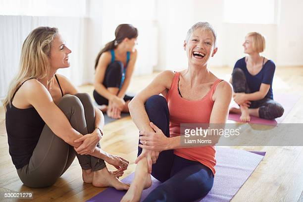 Four women sitting on floor in pilates class