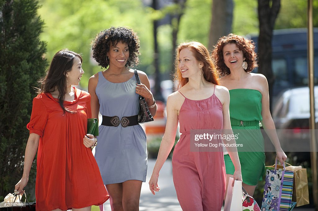 Four Women Walking City Street with Shopping Bags : Stock Photo