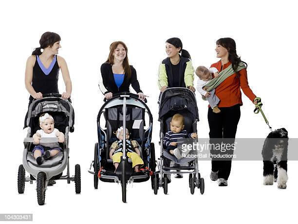 four women with their babies and a dog