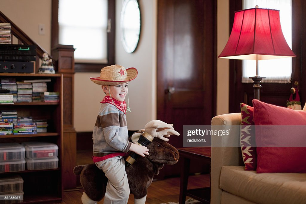 Four year old boy in livingroom : Stock Photo