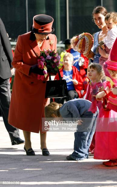 Four year old Edward Manfield makes a very low bow to Britain's Queen Elizabeth II as she leaves the Jubilee Library in Brighton today