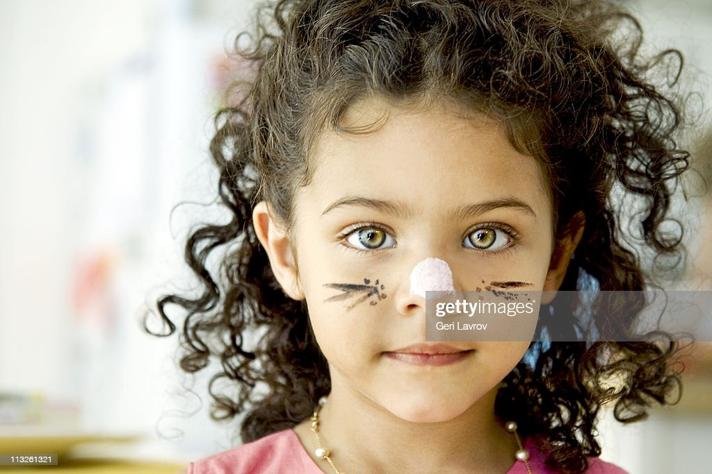 Four year old girl with face painted : Stock Photo
