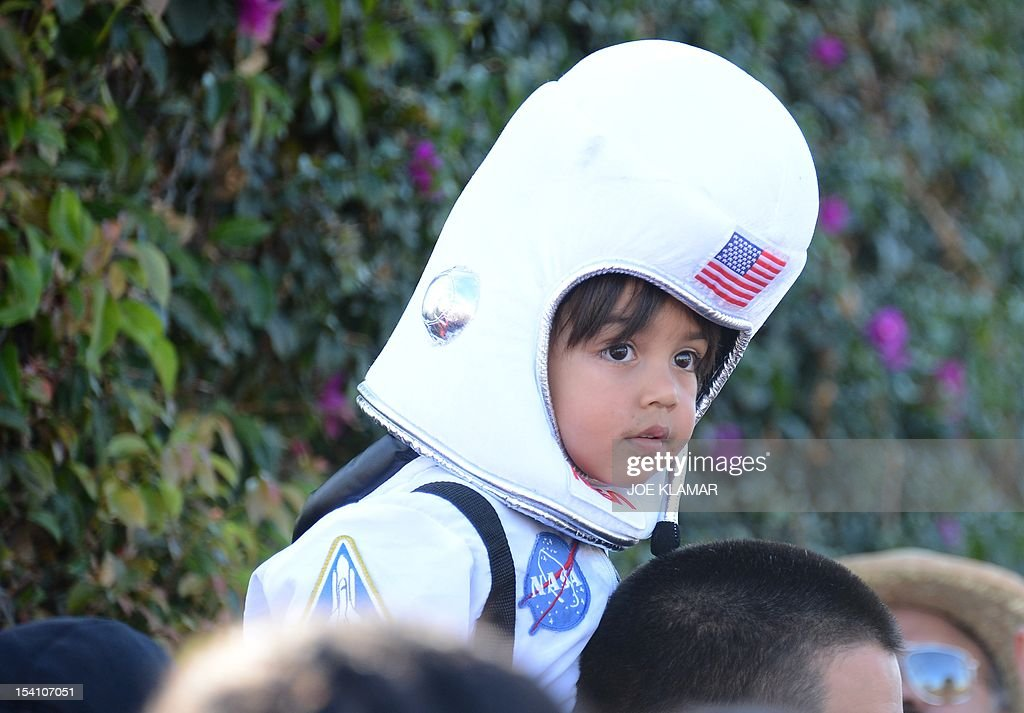 Four year old Levi is watching The Space Shuttle Endeavour is transported through the streets of Los Angeles on its final journey to its permanent museum home on October 13, 2012 in Inglewood, California. The 170,000-pound (77,272 kg) shuttle will travel at no more than 2 mph (3.2 km per hour) along a 12-mile (19km) route from Los Angeles International Airport (LAX) to its final home at the California Science Center. NASA's space shuttle program ended in 2011 after 30 years and 135 missions.
