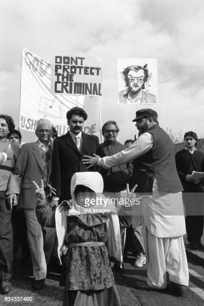 Four year old Rubina Ibrahim one of the youngest of Slough's 16000 Muslims gives a V sign at the head of a march through the town for a protest about...