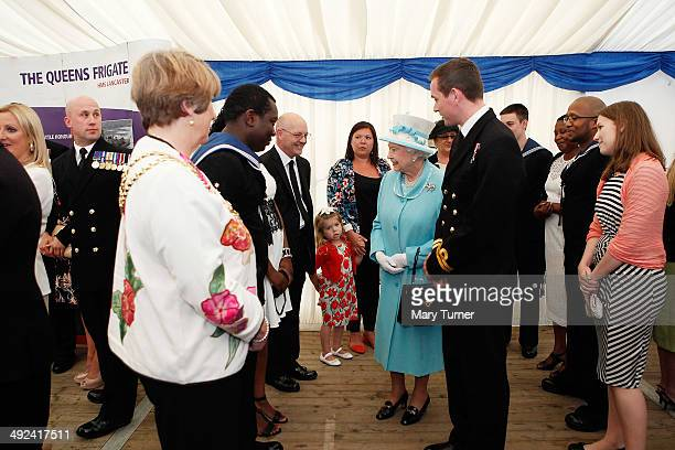 Four year old Ruby Paice appears unimpressed as she meets Queen Elizabeth II during a Royal visit to HMS Lancaster at Portsmouth Naval Base on May 20...