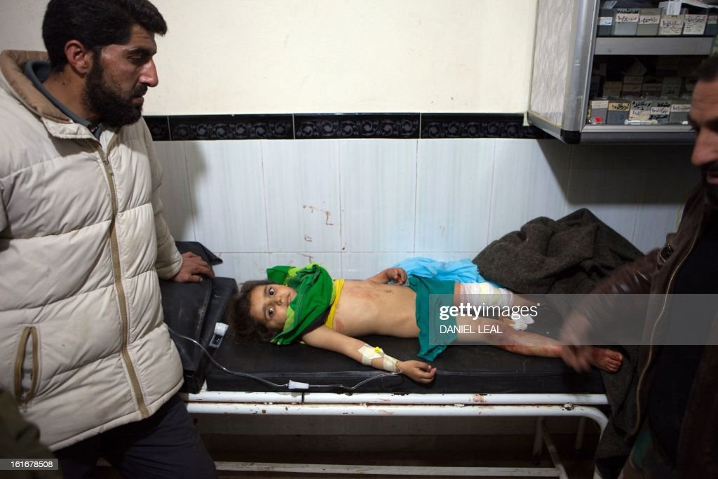 A four year old Syrian girl, Aya Himayed, lies in a hospital in Kfar Nubul after she was injured in an air strike on the town of Hass, in the northern Syrian province of Idlib, on February 14, 2013. A Syrian army jet fighter plane made an airstrike just after midday on the town of Hass killing at least 12 people, including four children.