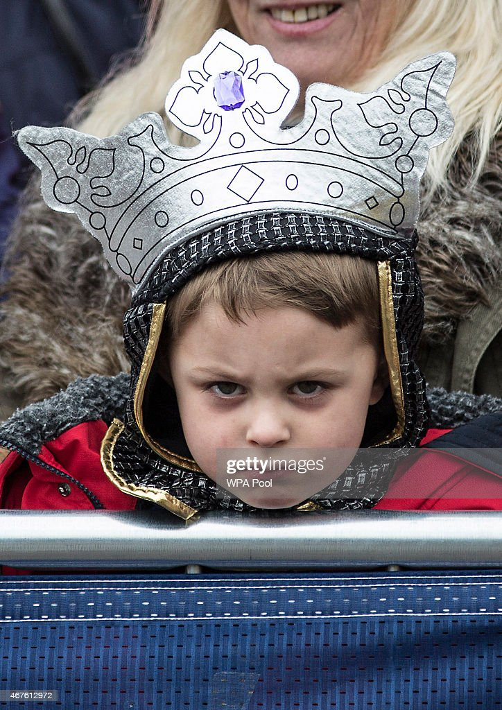 Four year old Torin Weston from Leicester, dressed as Richard III waits with his grandmother outside Leicester Cathedral for the reinterment ceremony of King Richard III, on March 26, 2015 in Leicester, England. The skeleton of King Richard III was discovered in 2012 benaeth a car park, in the foundations of Greyfriars Church in Leicester, 500 years after he was killed in the Battle of Bosworth Field.