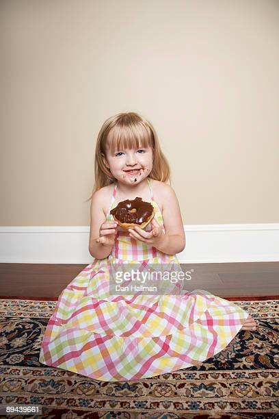 Four year old with donut.