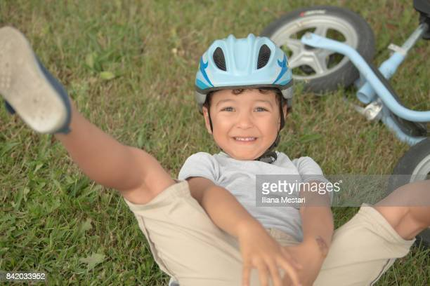 Four years boy and his bicycle
