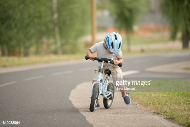 Four years old boy and his bicycle