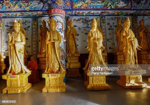 Four yellow budda in Ceramic pagoda