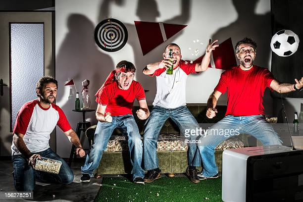 men watching soccer game on sofa stock photo getty images 1