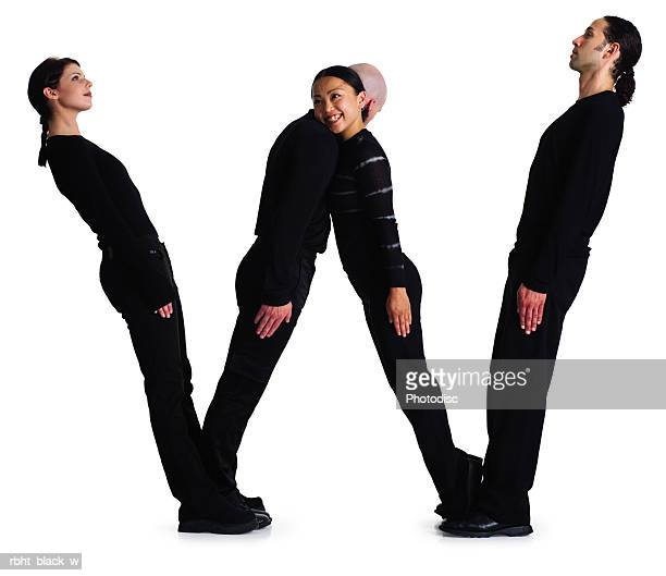 four young adults dressed in black create the letter W