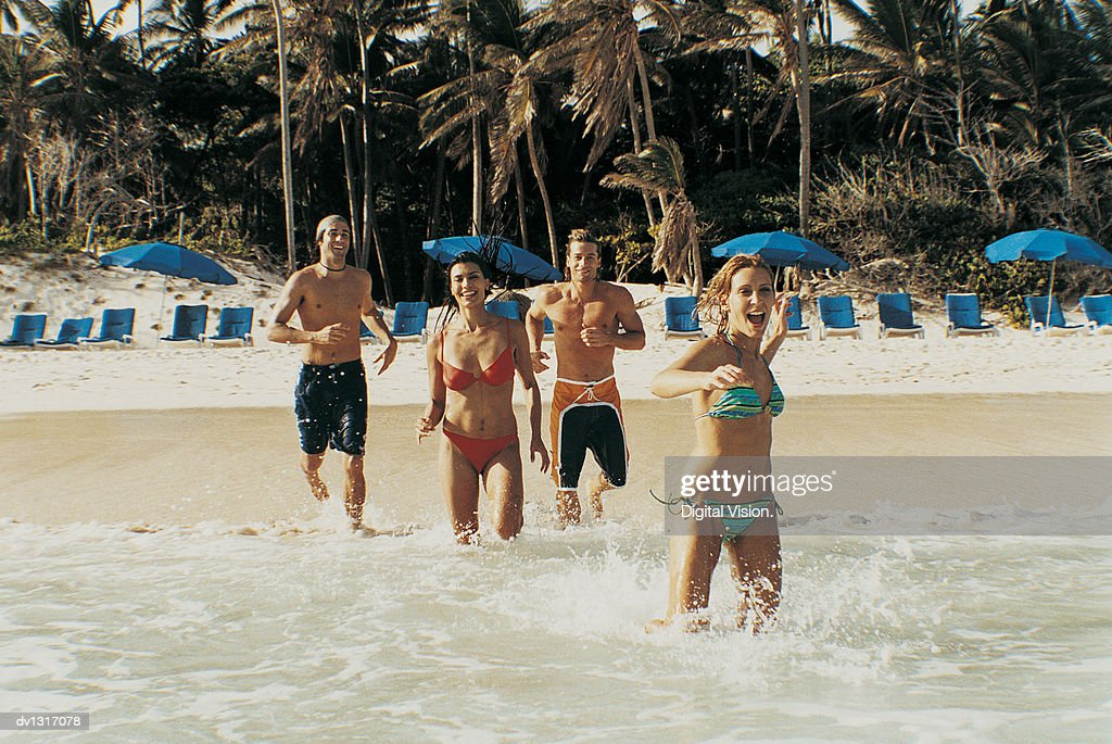 Four Young People Running into the Sea