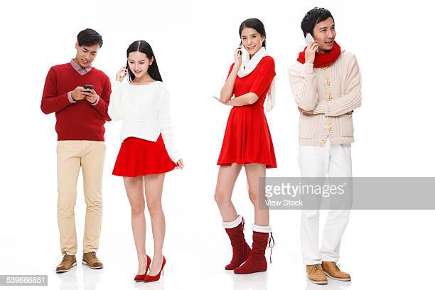 Four young people using cellphone