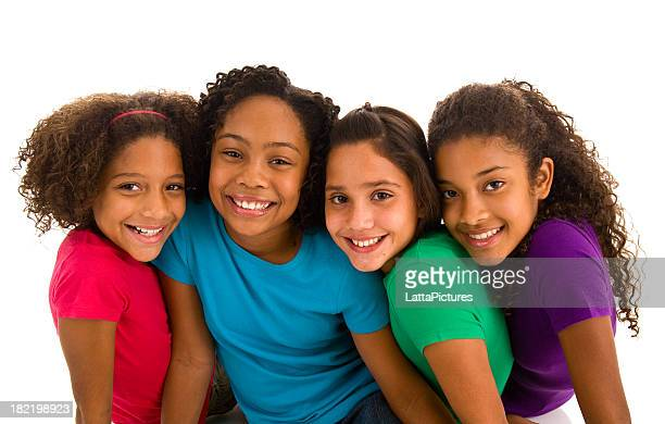 Four young teenage girls sitting close to each other