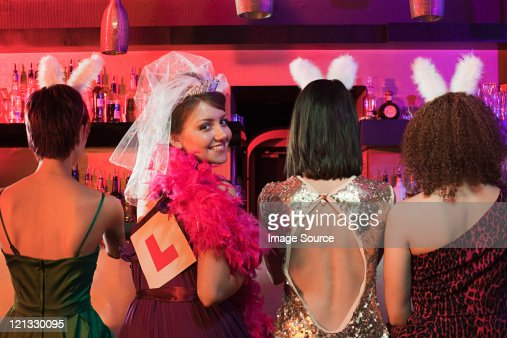 Four young women on hen night : Stock Photo