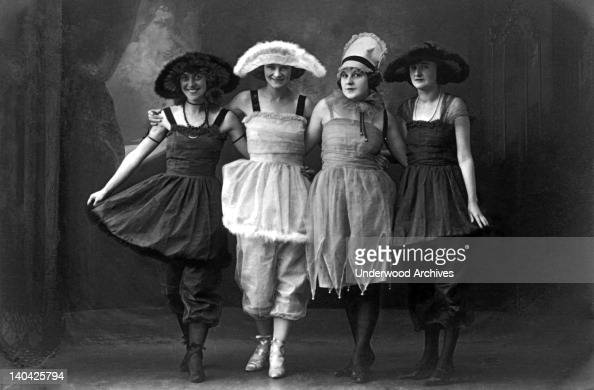 Four young women on the vaudeville stage in fancy costumes and hats San Francisco California circa 1890