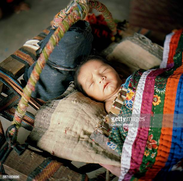 A fourdayold Meghwal baby sleeps peacefully in a traditional crib in Harijan Vaas one of the hamlets that make up the Hodka village His father Gagan...