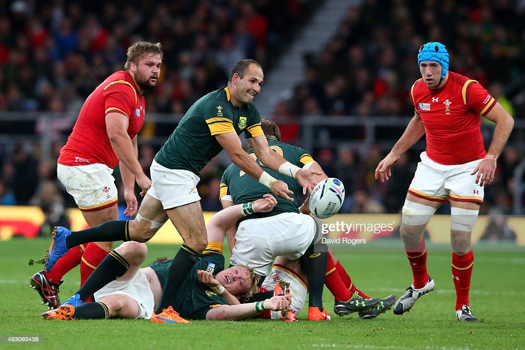 Fourie Du Preez of South Africa passes watched by Justin Tipuric of Wales and Tom Francis of Wales during the 2015 Rugby World Cup Quarter Final...
