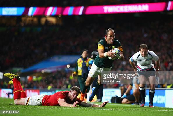 Fourie Du Preez of South Africa scores a try despite the diving tackle of Alex Cuthbert of Wales during the 2015 Rugby World Cup Quarter Final match...