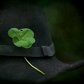 Four-leaf clover  pinned in a black hat.