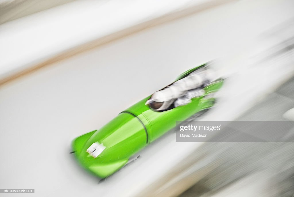 Four-man bobsled on track, blurred motion : Stock Photo