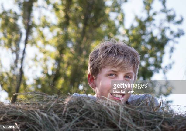 Fourteen-year-old in the hay