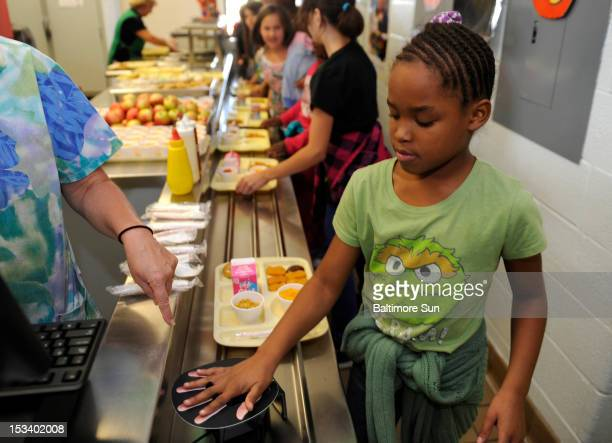 Fourth grader Makala Butler places her palm on a scanner to purchase her lunch at Roberton Moton Elementary School in Westminster Maryland on Octboer...