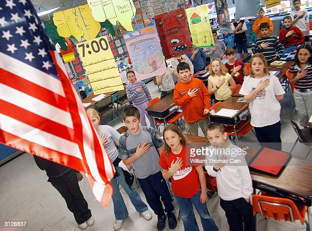 Fourth graders at Longstreth Elementary School pledge allegiance to the flag March 24 2004 in Warminster Pennsylvania An atheist parent Michael...