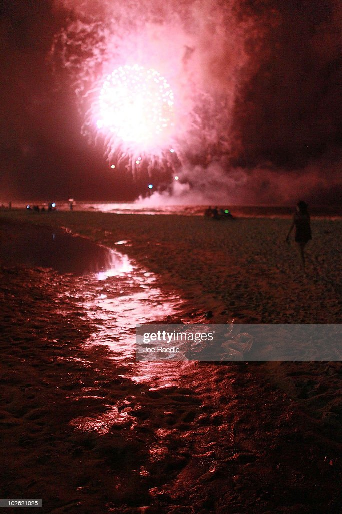 Fourth of July fireworks light up a slick of oil on the beach after it washed ashore from the Deepwater Horizon oil spill in the Gulf of Mexico on July 4, 2010 in Gulf Shores, Alabama. The oil spill may have a huge negative economic impact on gulf coast businesses during what should be a busy 4th of July. Millions of gallons of oil have spilled into the Gulf since the April 20 explosion on the drilling platform.