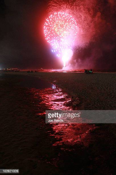 Fourth of July fireworks light up a slick of oil on the beach after it washed ashore from the Deepwater Horizon oil spill in the Gulf of Mexico on...