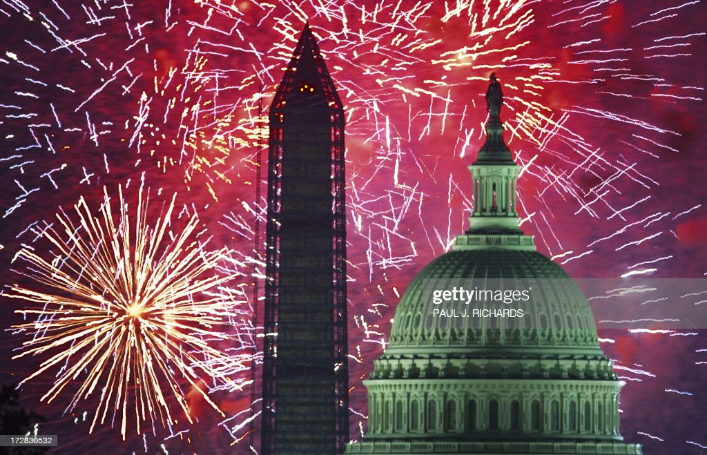Fourth of July US Independence Day fireworks are seed over the US Capitol and National Monument in Washington DC on July 4 2013 AFP Photo/Paul J...