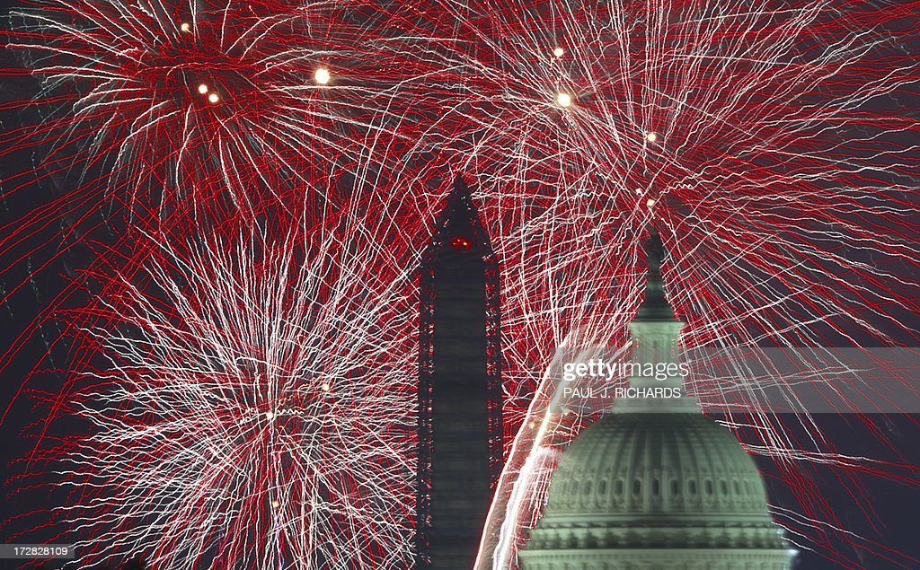 Fourth of July US Independence Day fireworks are seen over the US Capitol and National Monument in Washington DC on July 4 2013 AFP Photo/Paul J...