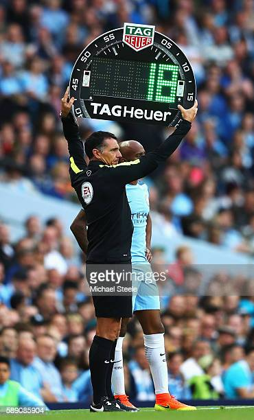 Fourth offical Neil Swarbrick holds up the LED board for a substitution during the Premier League match between Manchester City and Sunderland at...