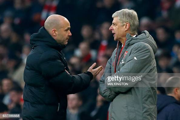 Fourth official Anthony Taylor points Arsenal's French manager Arsene Wenger to the tunnel after he was sent off by English referee Jonathan Moss...