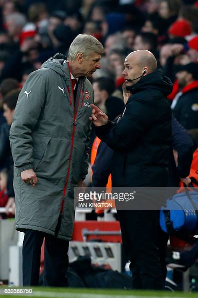 Fourth official Anthony Taylor speaks to Arsenal's French manager Arsene Wenger during the English Premier League football match between Arsenal and...