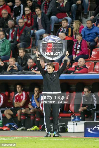 Fourth official Bas van Dongen holds up the substitution board
