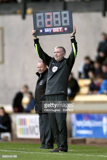 Fourth Official Gary Hilton holds aloft the substitute board