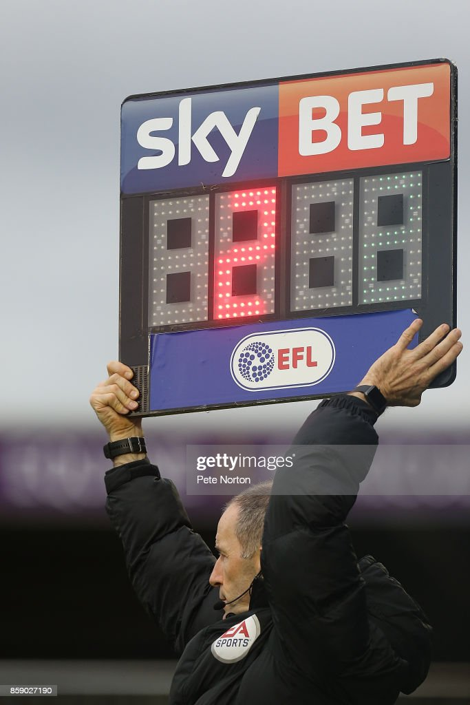 Fourth Official Graham Horwood holds up the board to show 2 minutes of added time during the Sky Bet League One match between Northampton Town and Bristol Rovers at Sixfields on October 7, 2017 in Northampton, England.