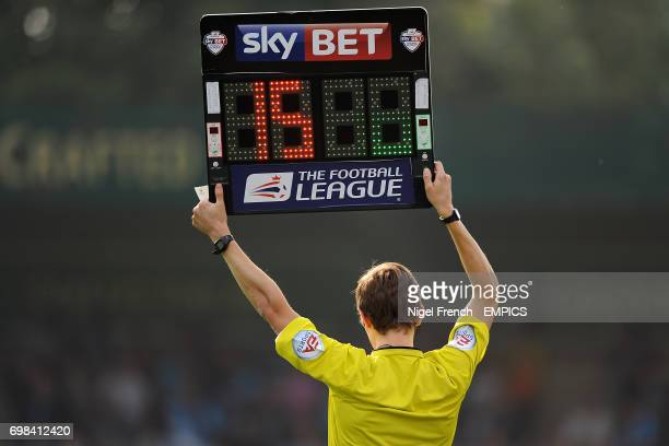 Fourth official holds up the electronic board to signify a substitution