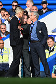 Fourth Official Jonathan Moss comes between Managers Arsene Wenger of Arsenal and Jose Mourinho manager of Chelsea during the Barclays Premier League...
