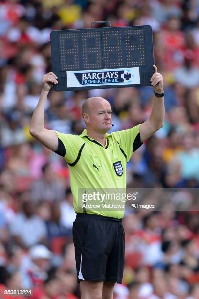 Fourth official Lee Mason holds up a Barclays Premier League LED substitute board