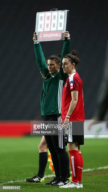 Fourth Official Lucy Oliver holds up the board as Barbara Dunst of Austria Women comes on as a substitute during the International Friendly match...