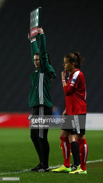 Fourth Official Lucy Oliver holds up the board as Laura Feeiersinger of Austria Women comes on as a substitute during the International Friendly...