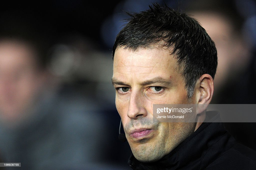 Fourth official Mark Clattenburg looks on during the Barclays Premier League match between Tottenham Hotspur and West Ham United at White Hart Lane on November 25, 2012 in London, England.