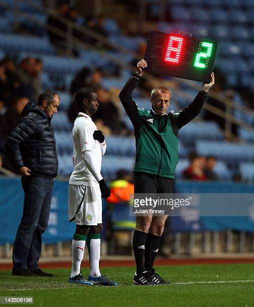 Fourth official Martin Atkinson holds the board up for a substitution during the London 2012 Olympic Qualifier match between Senegal and Oman at the...