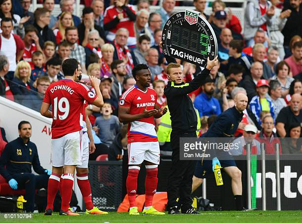 Fourth official Mike Jones holds an electronic board as substitute Adama Traore of Middlesbrough looks on during the Premier League match between...