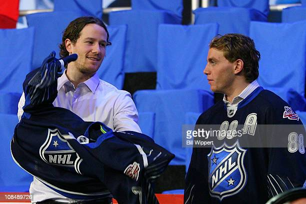Fourth pick Duncan Keith of the Chicago Blackhawks is selected for team Lidstrom as Patrick Kane of the Chicago Blackhawks looks on during the...