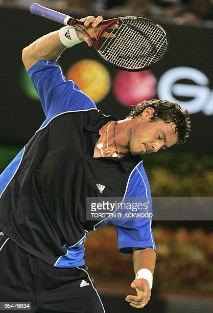 Fourth seed Marat Safin of Russia slams his racket onto the court in frustration while playing against top seed Roger Federer of Switzerland in their...